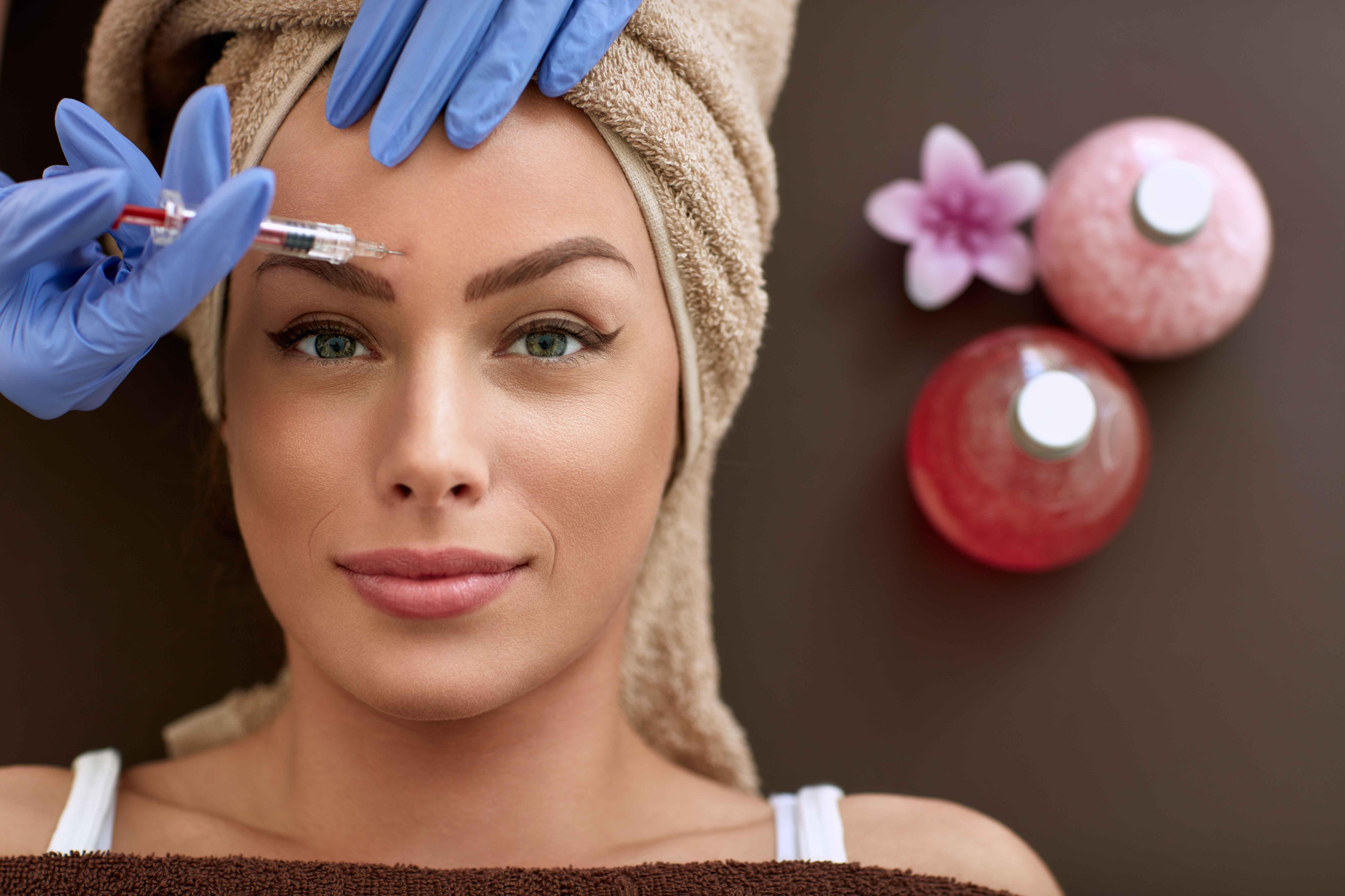 Beautiful woman receiving botox injections